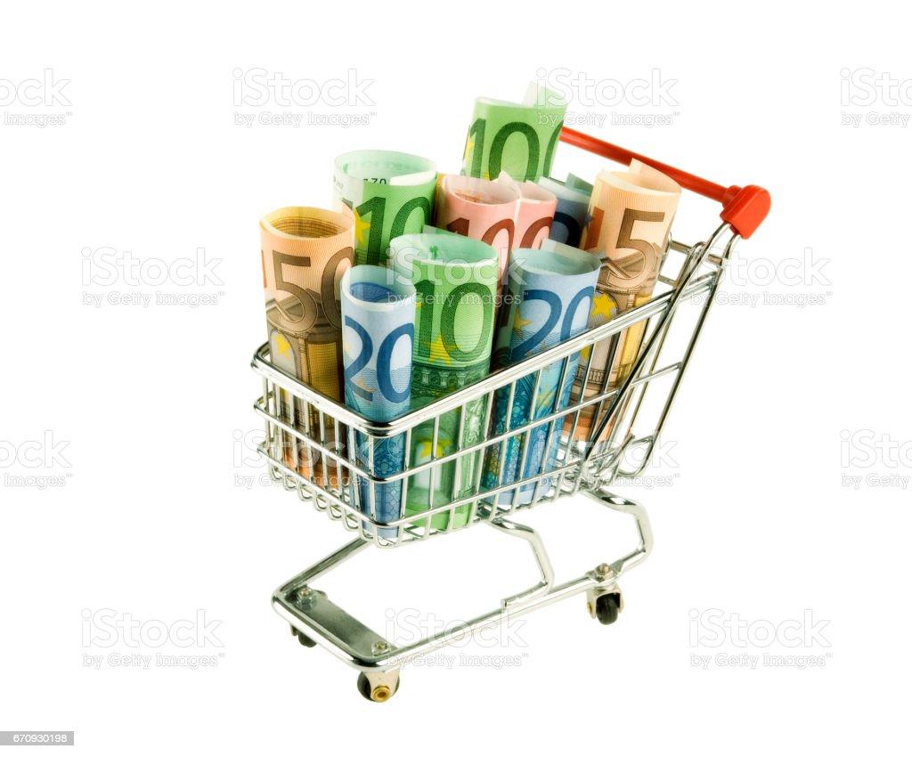 Einkaufswagen mit Geldscheinen stock photo