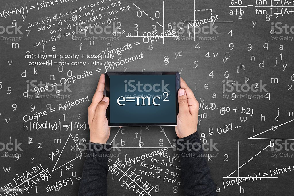 Einstein formula E=mc2 on digital tablet stock photo