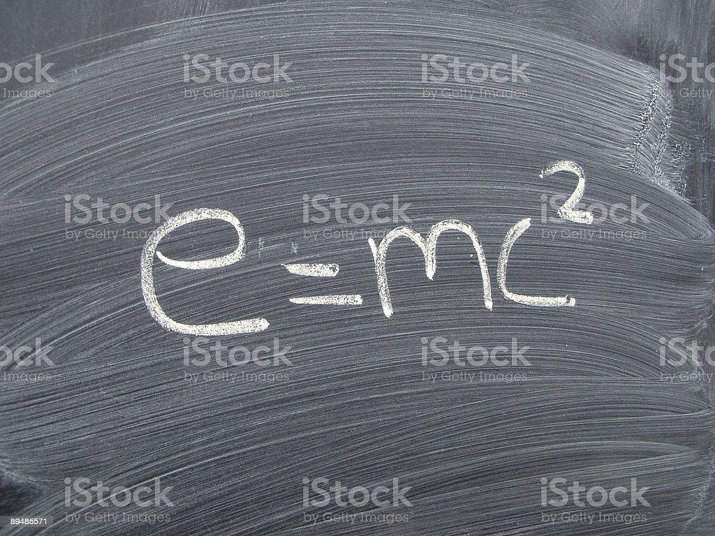 Einstein's equation of relativity on blackboard stock photo