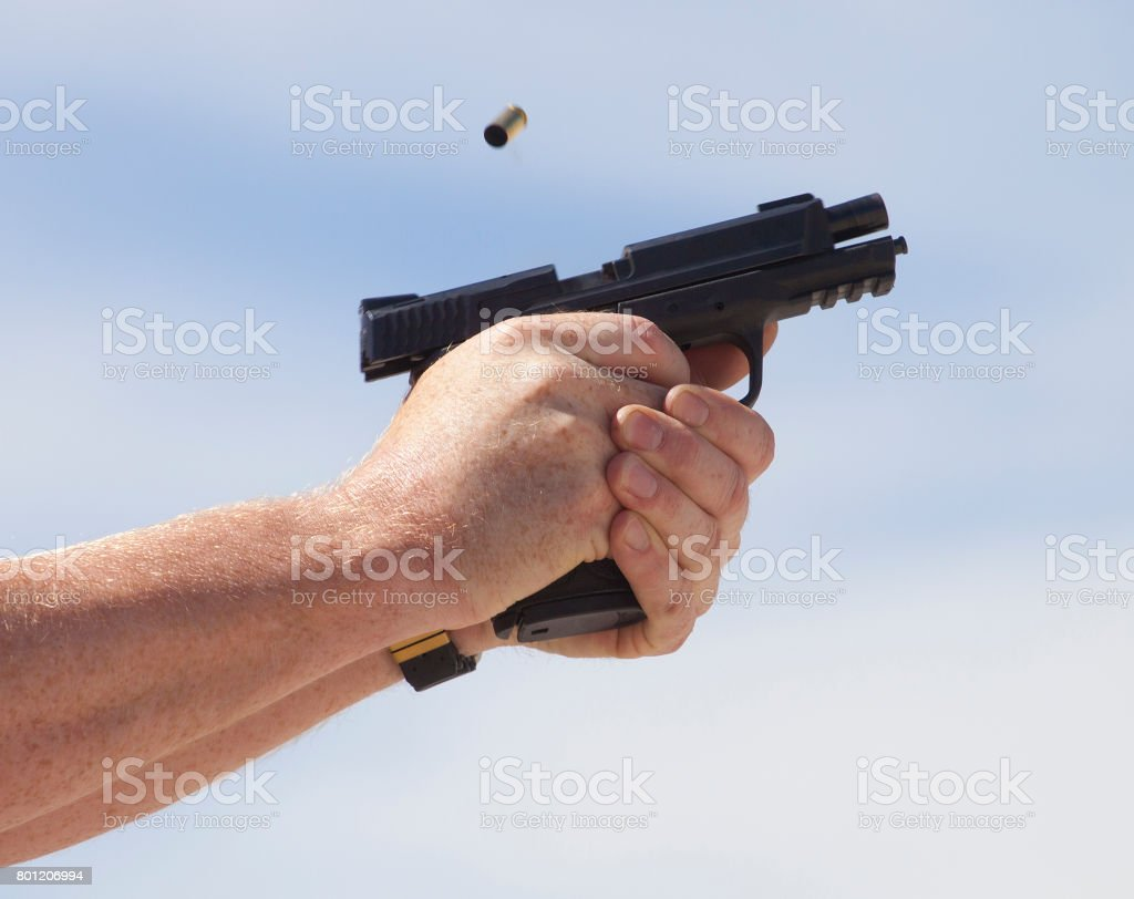 Ejecting an empty shell stock photo