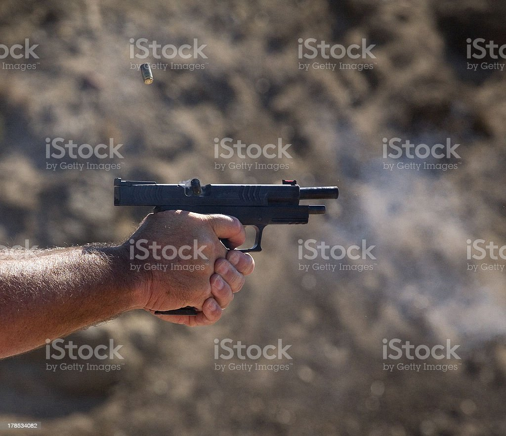 Ejecting brass royalty-free stock photo
