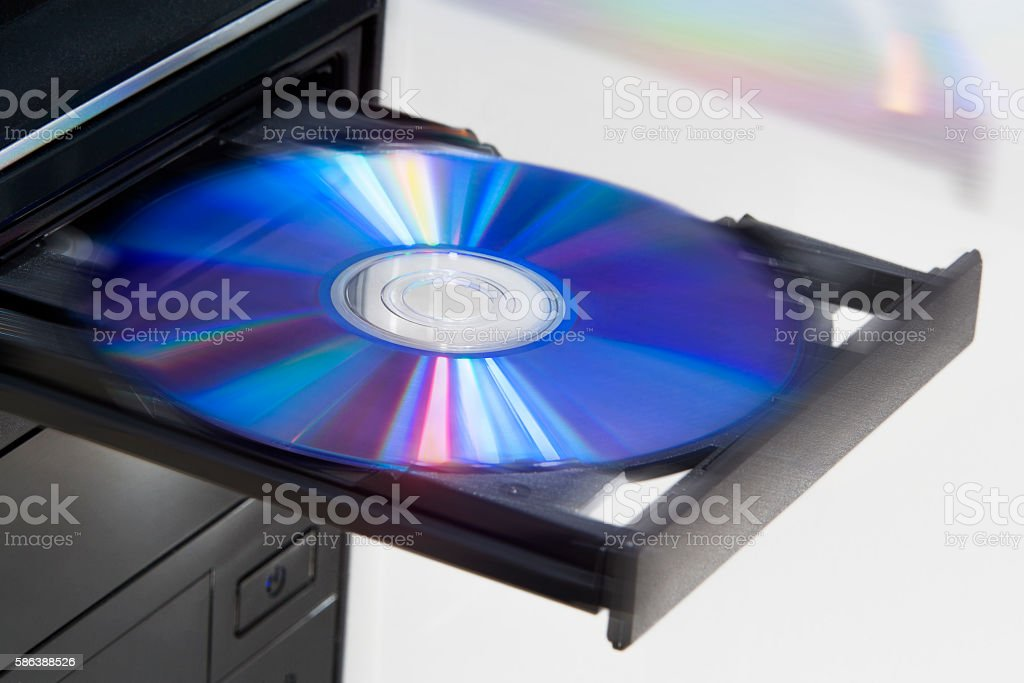 Ejecting disc from desktop computer stock photo