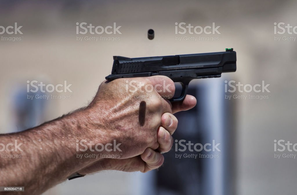 Ejecting handgun stock photo