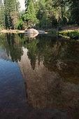 El Capitan reflecting in the Merced River.
