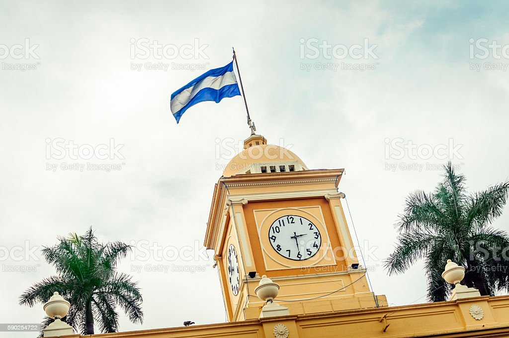 El Salvador Flag in Clock Tower stock photo