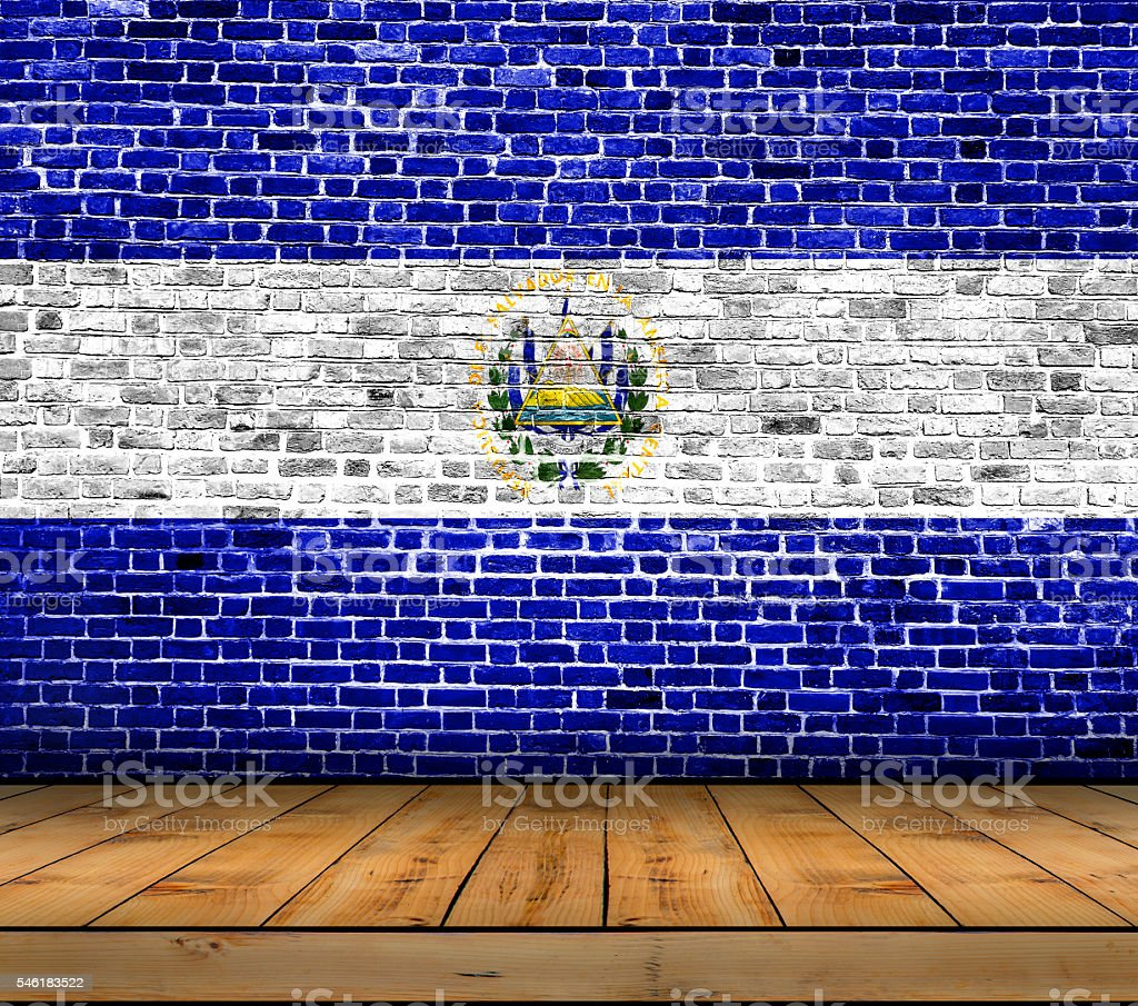 El Salvador flag painted on brick wall with wooden floor stock photo