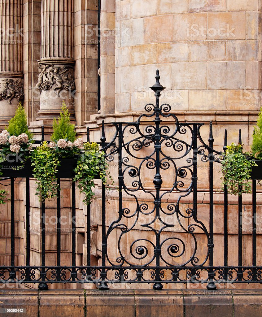 Ornamental wrought iron gates - Elaborate Ornamental Wrought Iron Fence And Handcarved Fluted Columns London Royalty Free Stock Photo
