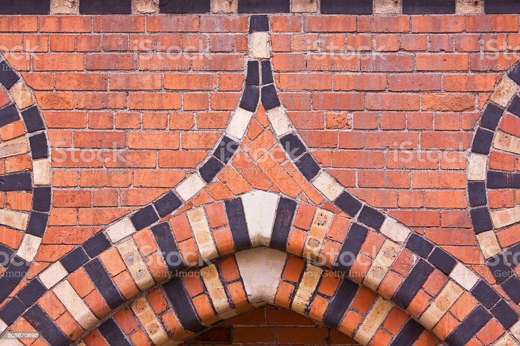 Elaborately patterned brickwork of a former granary UK stock photo
