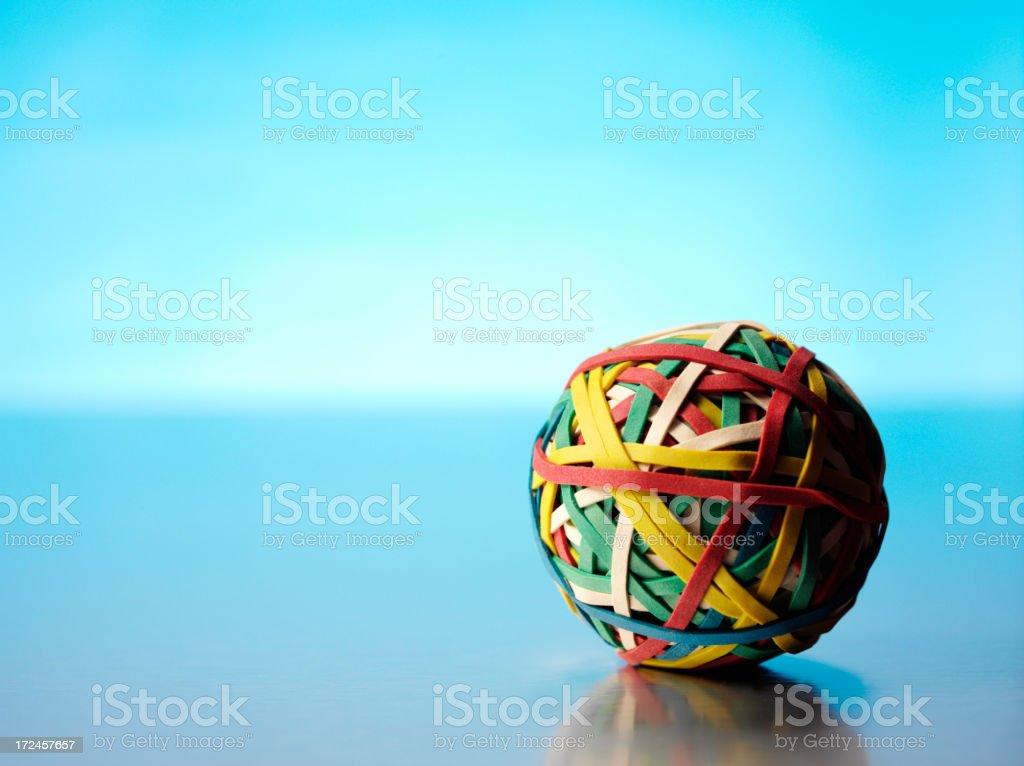 Elastic band ball with Blue lighting stock photo