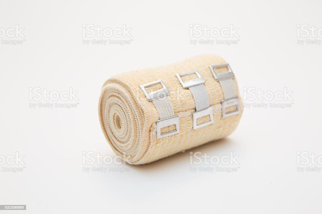 elastic bandage on a roll on white background stock photo