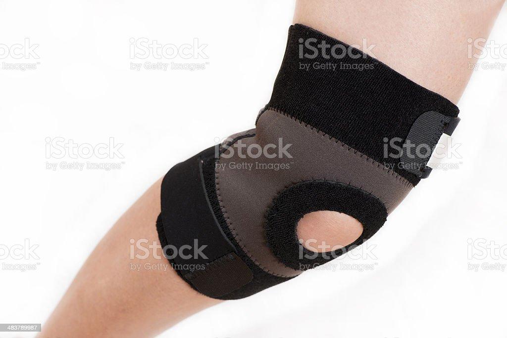 Elastic bandage on knee stock photo