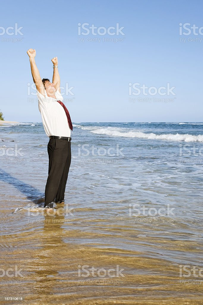 Elated Businessman Standing on Hawaiian Beach royalty-free stock photo