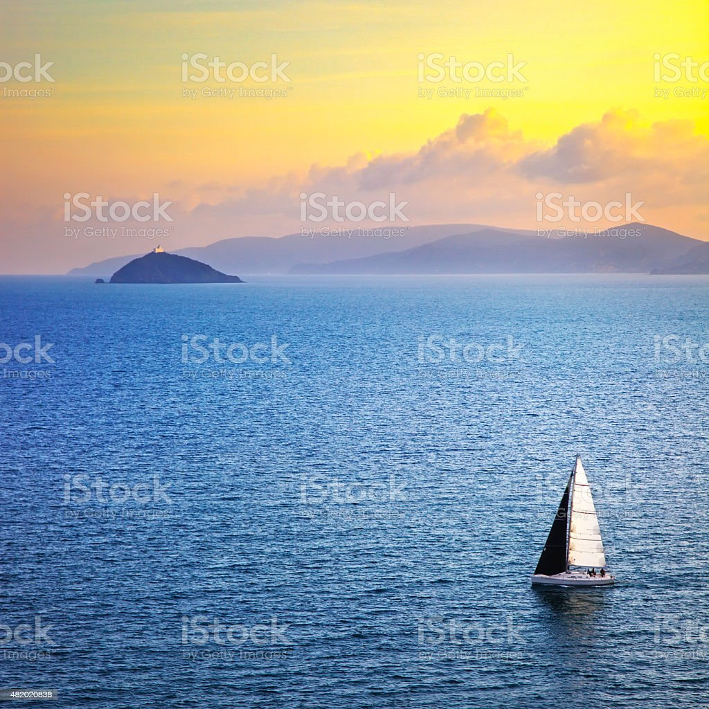 Elba island sunset view from Piombino an sail boat. Mediterranea stock photo