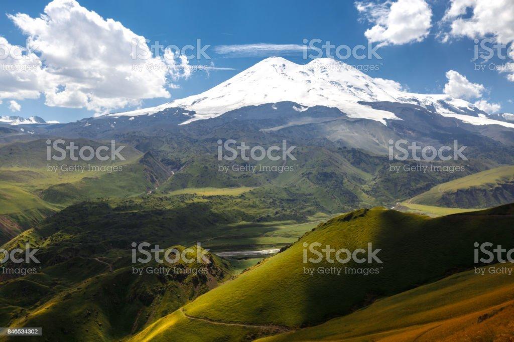 Elbrus And Green Hills At Sunny Summer Day. Elbrus Region, Northen Caucasus, Russia stock photo