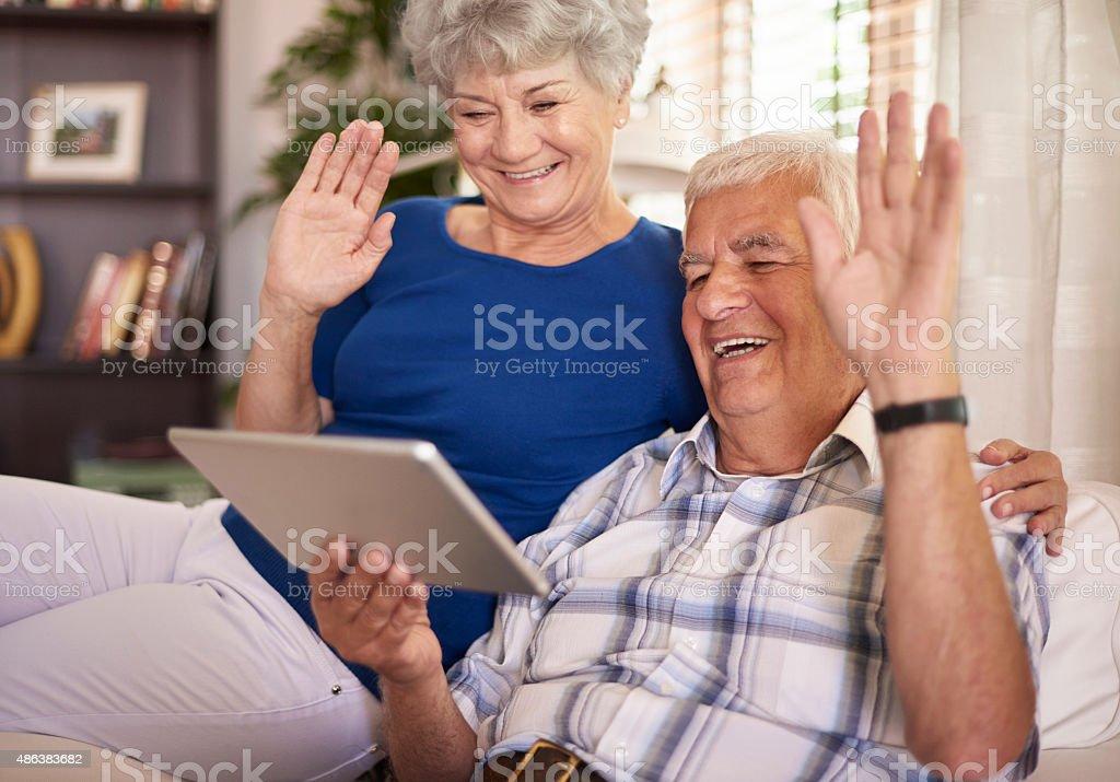 Elder couple having a video conversation stock photo