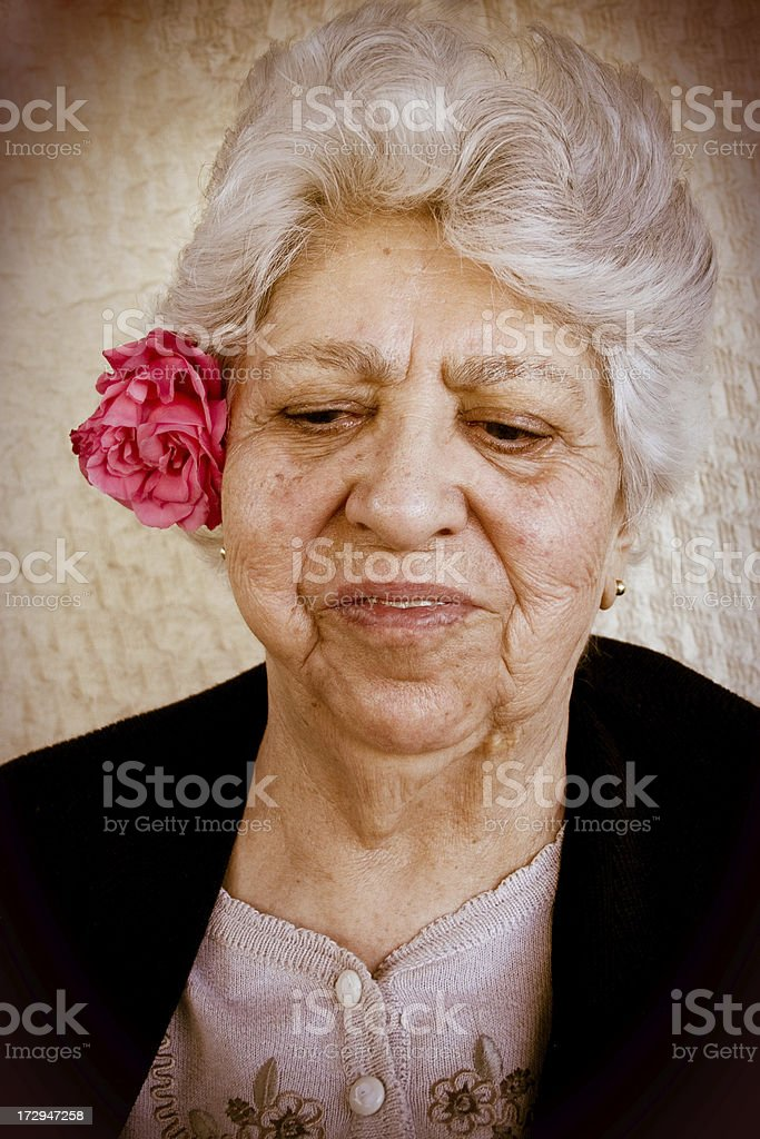 Elder female with rose stock photo