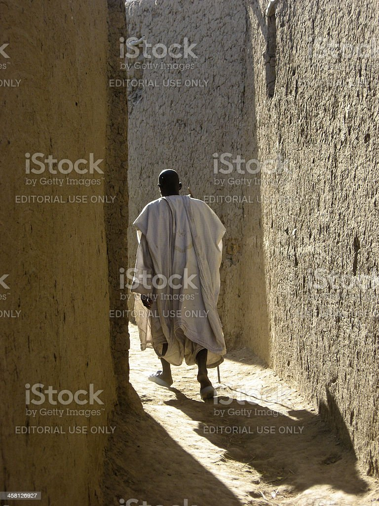 Elder in the alleyways of Saba (Mali, Africa) royalty-free stock photo
