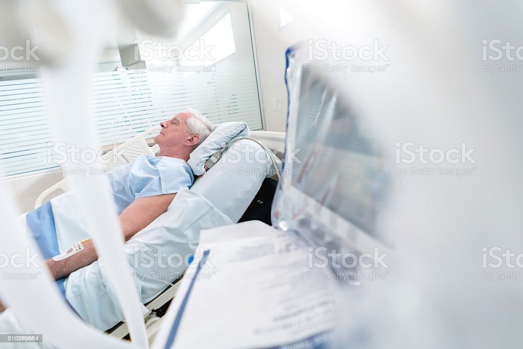 Elder man at the Intensive Care Unit stock photo