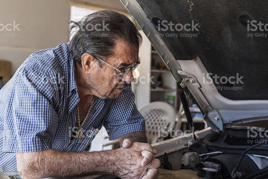 Elder Man in Garage royalty-free stock photo