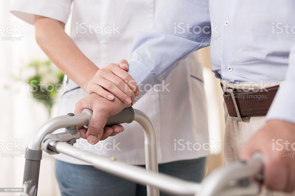 Elder man is too weak stock photo