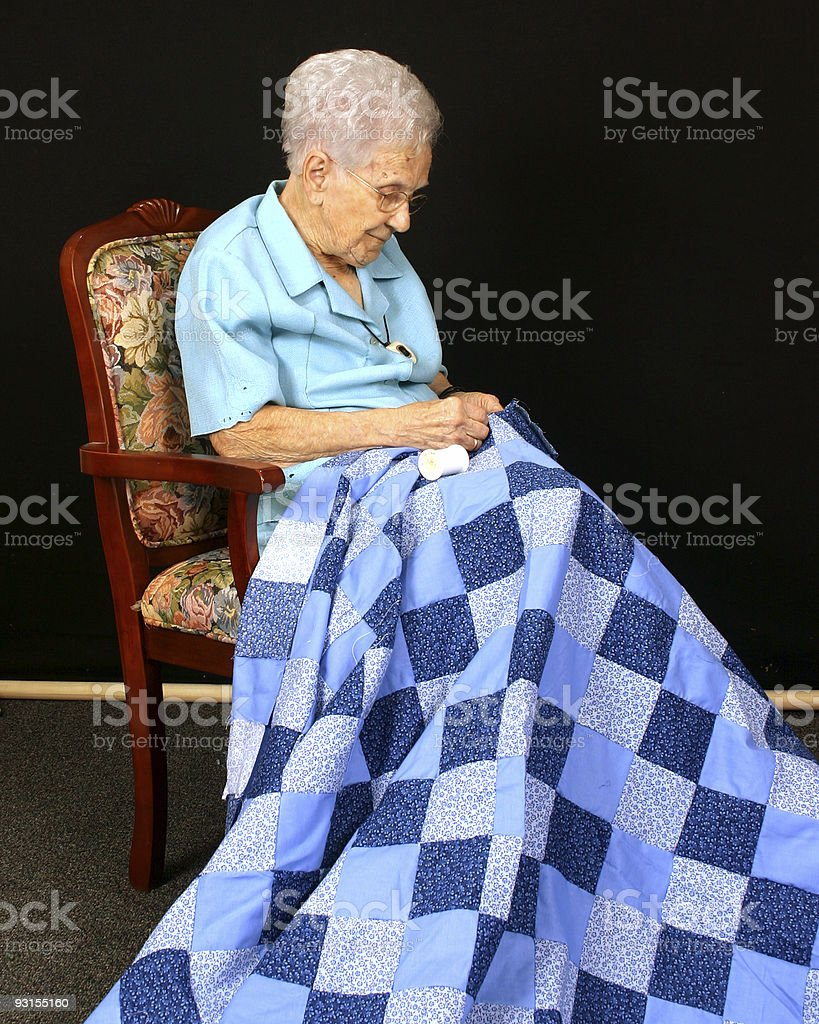 Elder Woman and Her Quilt stock photo