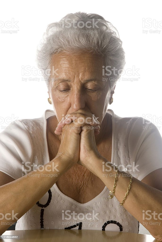 Elder woman in deep prayer royalty-free stock photo