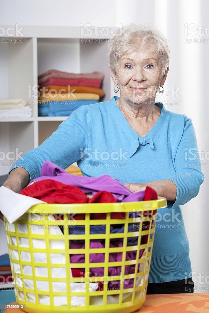 Elderdly lady with washing stock photo
