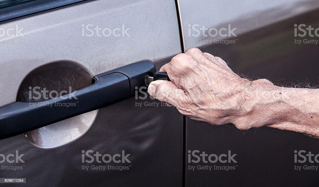 Elderly 90 Year Old Man's Hand Unlocking Car Driver Door stock photo
