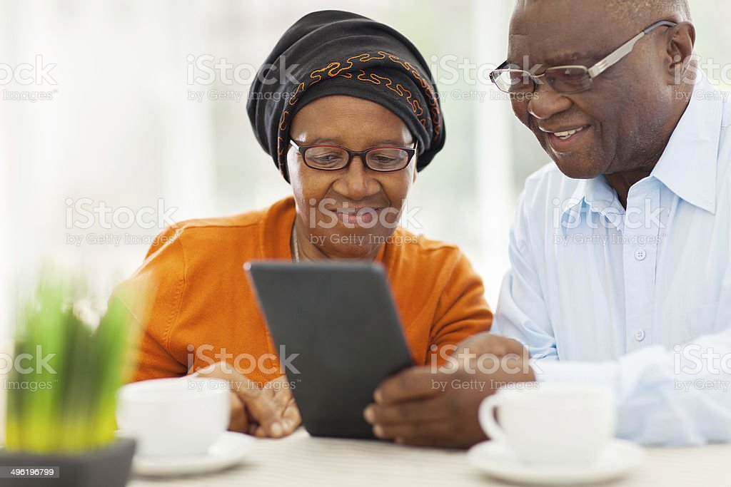elderly african couple using tablet computer stock photo