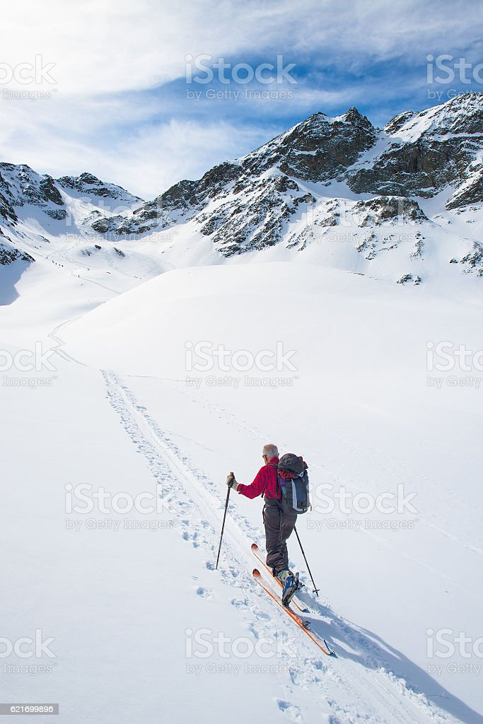 Elderly alpine skiers stock photo