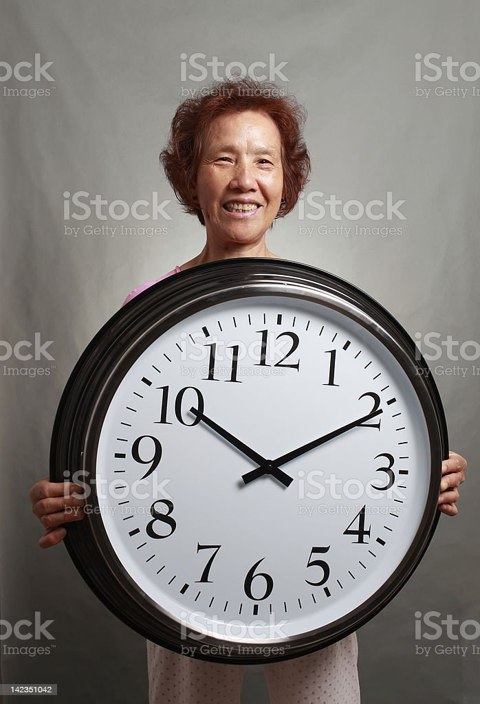 Elderly and the clock royalty-free stock photo