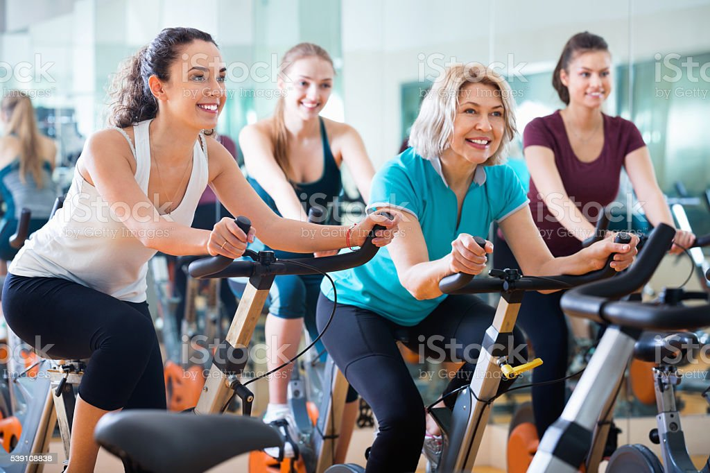 Elderly and young women working out hard stock photo