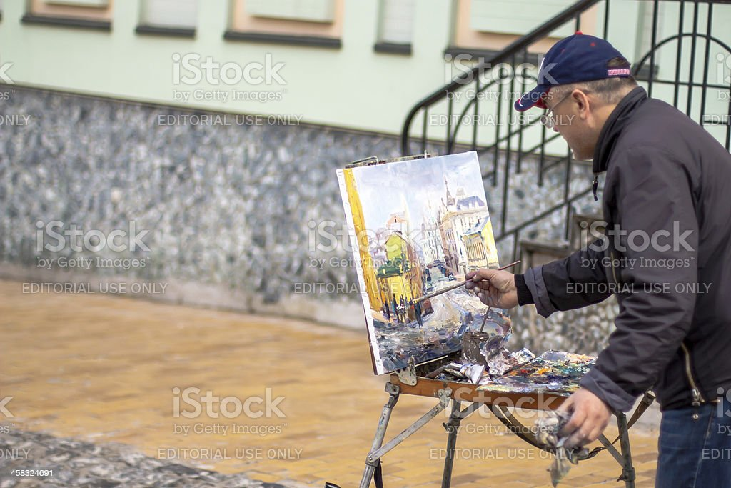 Elderly artist paints a picture of oil royalty-free stock photo