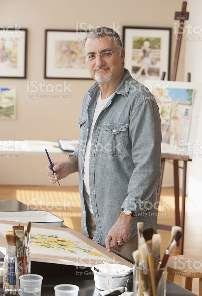 Elderly artist working at home royalty-free stock photo