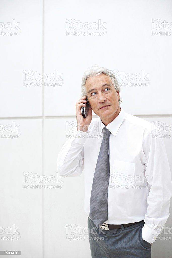 Elderly businessman talking on cellphone royalty-free stock photo