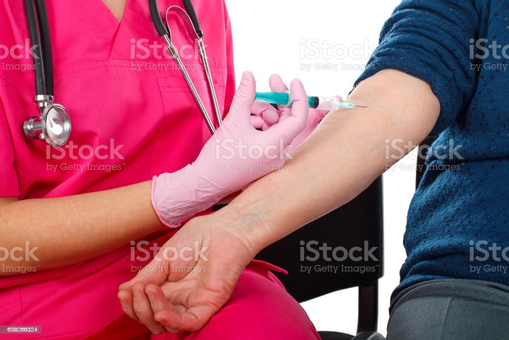 Elderly care - injection stock photo