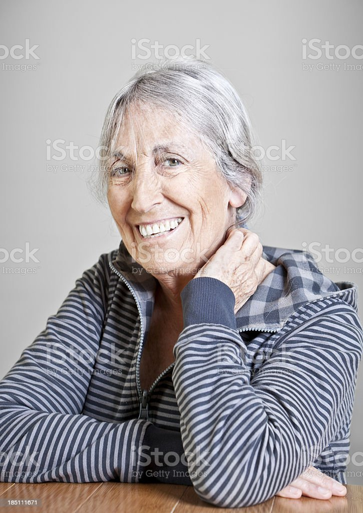 Elderly casual woman smiling royalty-free stock photo