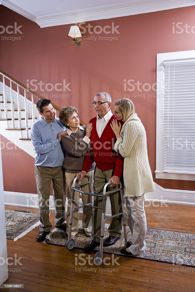 Elderly couple at home with adult children royalty-free stock photo