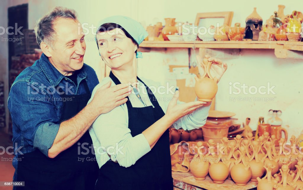 Elderly couple at pottery workshop stock photo