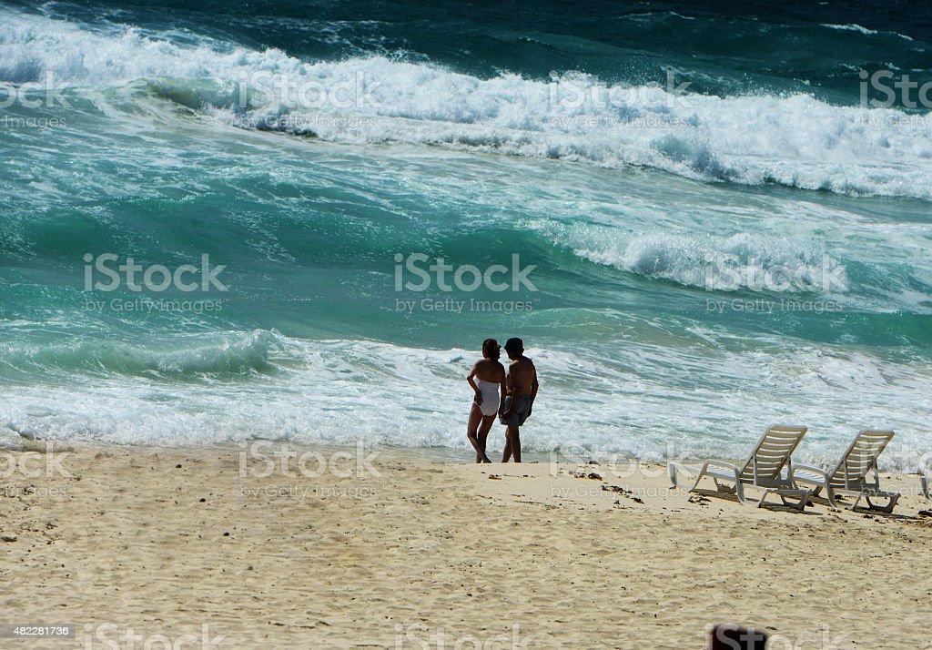 Elderly couple at the beach stock photo