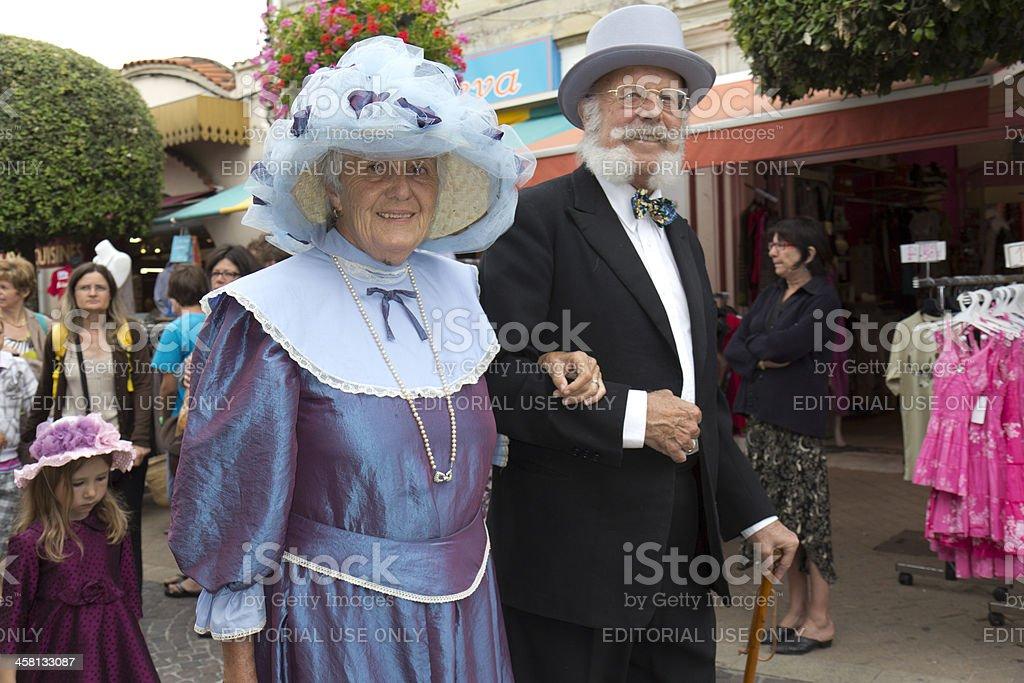 Elderly couple during a parade. stock photo