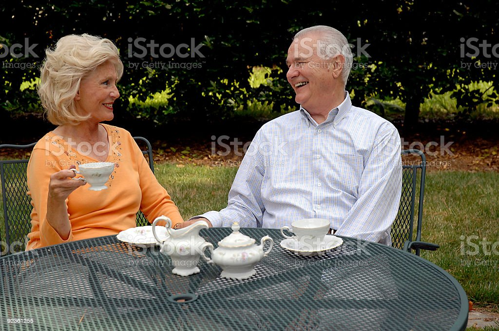 Elderly Couple Having A Cup Of Coffee royalty-free stock photo