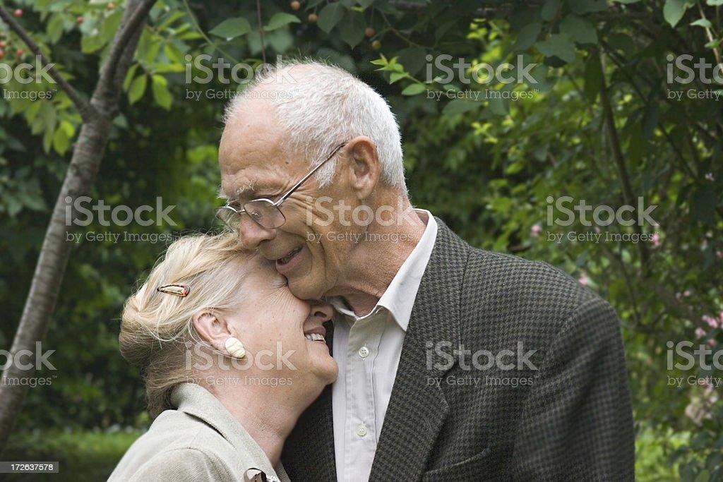 Elderly couple hugging royalty-free stock photo