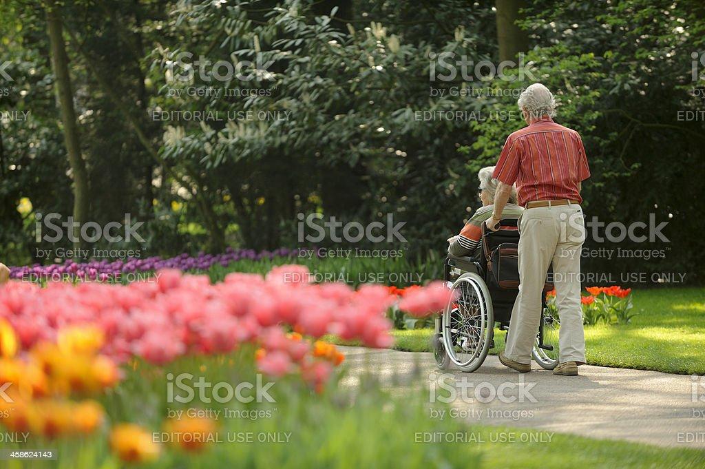 Elderly couple in flower park Keukenhof the Netherlands royalty-free stock photo