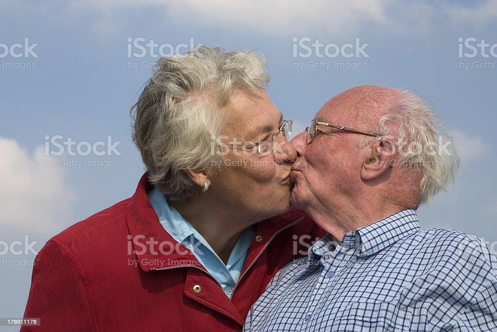 Elderly couple kissing royalty-free stock photo