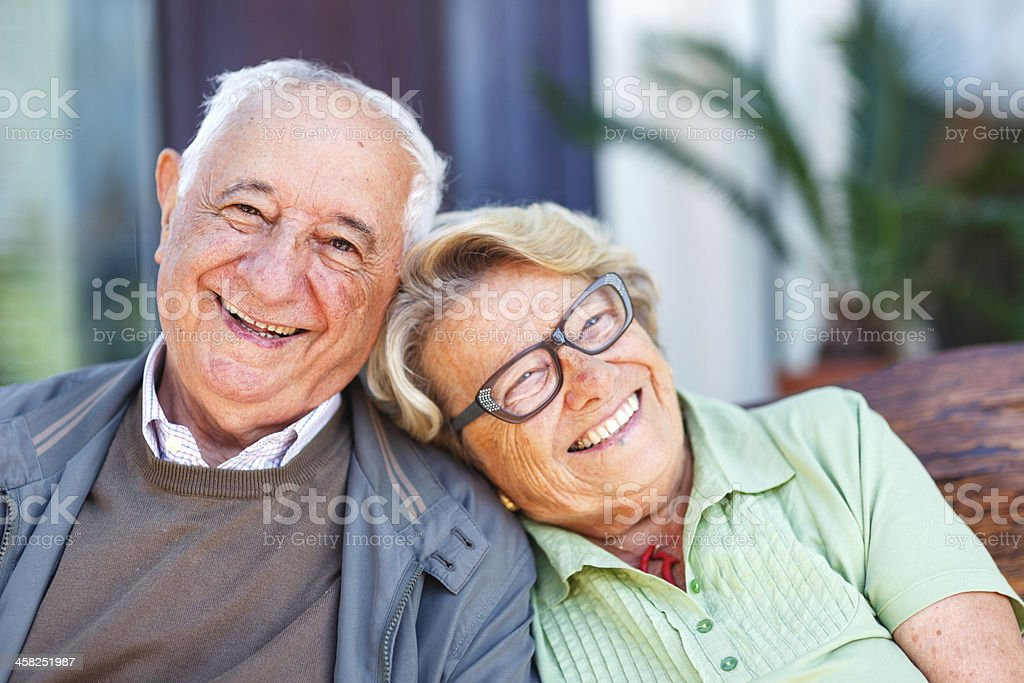 Elderly couple laughing stock photo