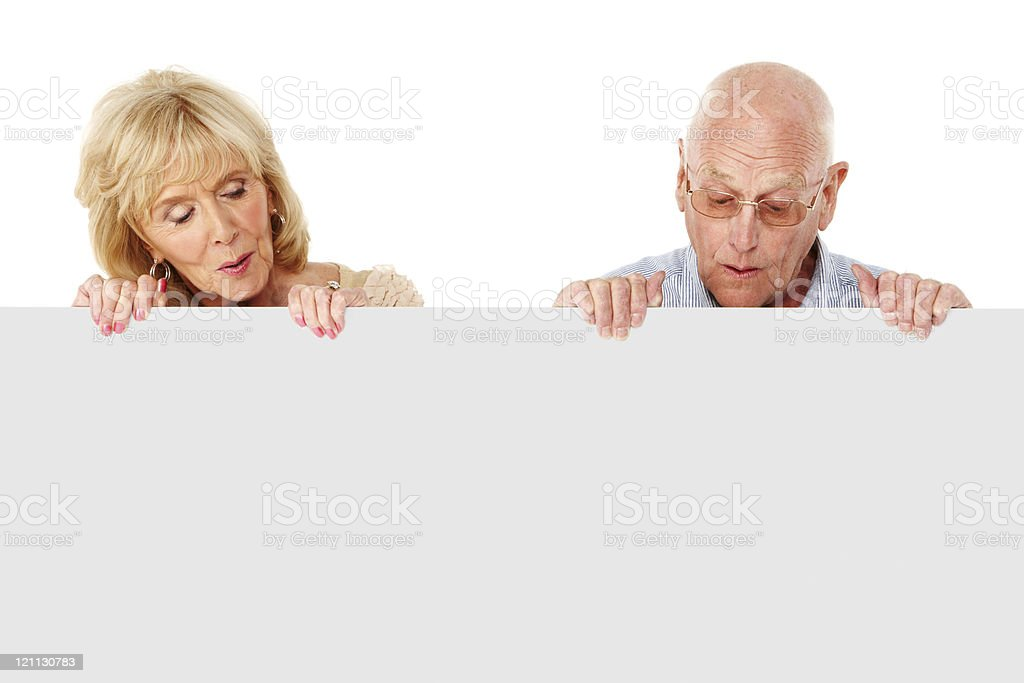 Elderly Couple Looking Down at a Blank Wall - Isolated stock photo