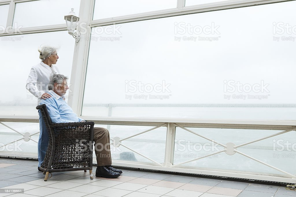Elderly couple looking in the distance royalty-free stock photo