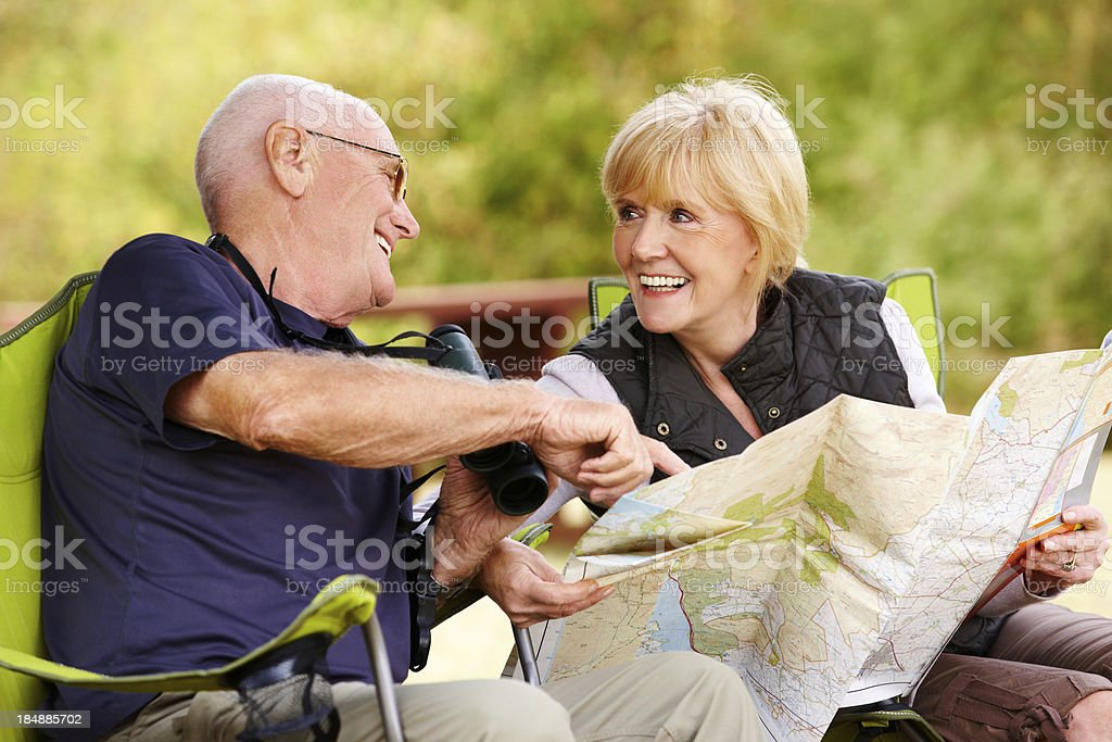 Elderly Couple Looking Over a Map royalty-free stock photo