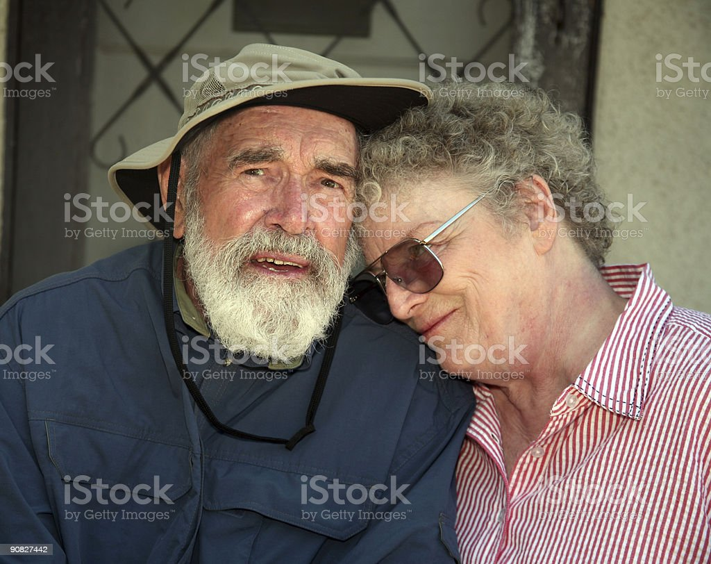 Elderly couple on a porch royalty-free stock photo